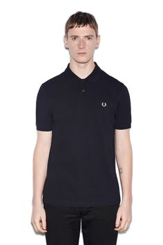 The one-colour Fred Perry shirt. Designed in-line with the original tennis shirts worn by Fred in the '50s, the M6000 was designed with a focus on lightweight functionality. Cut with a streamlined silhouette and definitive two-button placket, it's made in our regular cotton piqué. No extras, just the Laurel Wreath at the chest.