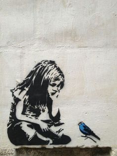 Banksy Girl with blue bird.