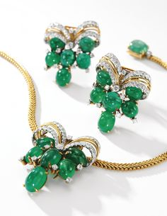 Emerald and diamond necklace, Cartier, 1950s Decorated with three detachable clips set with cabochon emeralds and circular-cut diamonds, the necklace clasp similarly set, length approximately 360mm, each signed Cartier, numbered, French assay and maker's marks.