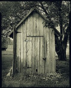 """Whitewashed outhouse - Uppervile, Virginia    I photographed this outhouse on a farm in Upperville, VA with a 4""""x5"""" camera. The structure had been around at least since the 1930's. It was painted with whitewash."""