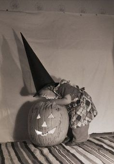 Wee Witch, big pumpkin.