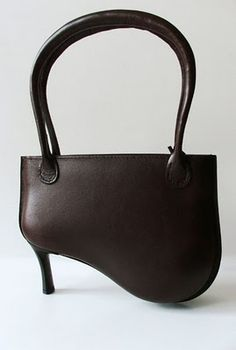 Black leather high-heel handbag with red interior - #productdesign
