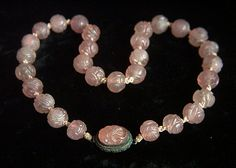 From an estate collection. This is a fabulous, stunning,  and rare antique Chinese necklace of carved rose quartz (also called pink jade in China)