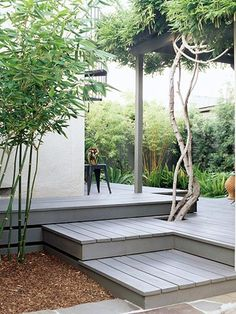 Punctuate the Surface Cut a hole near an edge of the deck and plant your favorite flowers or small trees so they can grow up through the boards.