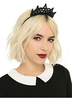 <p>You'll look and feel like the gothic princess of the world when wearing this headband designed with a beaded crown. Pair with your favorite dress for a day of fun.</p>  <ul> 	<li>Imported</li> </ul>