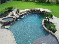 In ground pool with diving board, slide, and hot tub