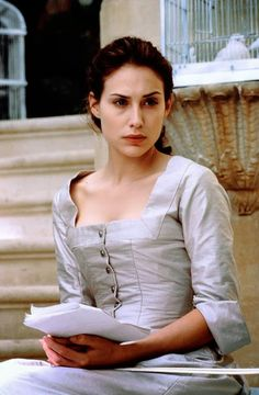 Claire Forlani as Julia Sherwin in Basil (1998).