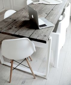 that apple thing! what i most like is the combination of those white chairs and the wooden table. nice