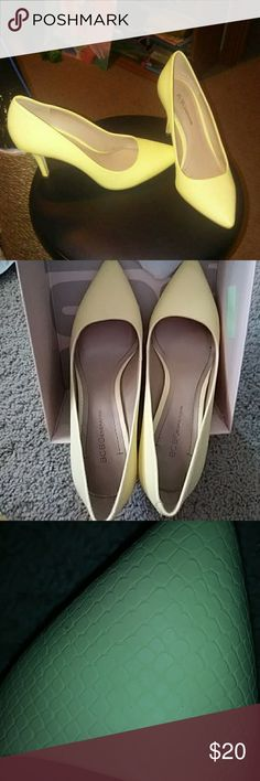 Lemon Chiffon BCBGeneration Pumps Almost reptile like texture of matte pastel yellow pumps, third photo shows texture best. Worn a few times, but in like new condition. BCBGeneration Shoes Heels