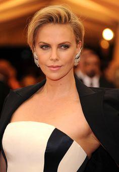 Red carpet hairstyle. grown-out pixie cut - Charlize Theron. Celebrity Hairstyle. Met Gala 2014