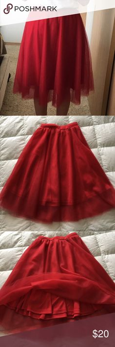 """Red Tulle Full Midi Skirt. Stretch waist band. Red Tulle Full Midi Skirt. Attached under skirt. Worn twice. Length 25"""" and a stretch waist band. Charlotte Russe Skirts Midi"""