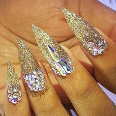 Gold glitter is the easy way to create shimmer manicure that will be   perfect for any occasion. Click to see more nail art ideas. #nailart   #naildesigns #goldglitter