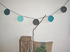 Such sweet shades of blue in this crochet flower bunting!