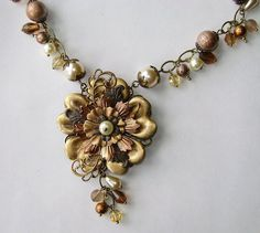 """""""Falling for You"""" by Novegatti Designs. all B'Sue brass components in the flower, along with Spectra beads (also from B'Sue's) and various glass pearls and beads in the chain and dangles. www.facebook.com/NovegattiDesigns"""