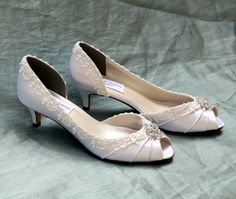 "Ivory heels 1.75""-Corrisa - Wide shoes available - low heel With a 1.75"" heel these enchanting peep toes feature delicate ivory Venetian lace and a crystal brooch. Pictured in Medium Ivory Tu-577 COMPLETION AND SHIPPING TIME: This style is on a 4 week lead time + Shipping Time ***Shipping within USA is typically one week. International shipping typically takes 6-10 business days. RUSH ORDERS:"