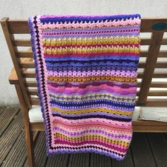 Cosy up on chilly evenings with this Bollywood-inspired crochet blanket. Crocheted in premium acrylic yarn in rich shades of cream, mustard, pink and purple. This blanket measures approx 75 x and is the perfect size for keeping your legs warm in . Crochet Gifts, Crochet Hooks, Yarn Colors, Colours, Sofa Blanket, Textile Art, Cosy, Gift Guide, Spice