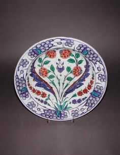 Maker:    Unknown; potter    Category:    fritware (stonepaste)    Name(s):    dish  Islamic pottery; category  Iznik; category    Date:    circa 1575 — circa 1580    School/Style:    Ottoman    Period:    late 16th Century