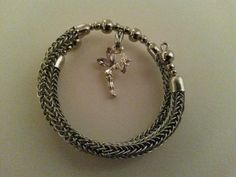 Viking knit bracelet made with stainless steel wire and a titanium memory wire core. Features a sterling silver Tinkerbell charm with pink Swarovski crystal wings. Find this and MUCH MORE at: https://www.amazon.com/handmade/kydanjenjewelry
