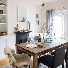 Scandi dining room with a modern mix of furniture Create a relaxed dining space with Scandinavian-inspired styling and take a modern approach to furnishing by mixing and matching finishes Cosy Dining Room, Dining Room Fireplace, Dining Room Lighting, Dining Room Design, Dining Rooms With Fireplaces, Scandi Dining Table, Dining Room Shelves, Small Living Dining, Living Room