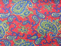 Vintage 70s supply red blue green gold paisley fabric ribbed by Hannahandhersisters on Etsy