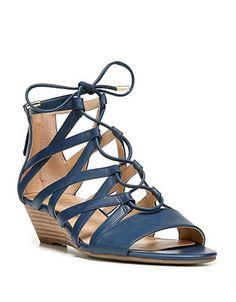 """<ul> <li>Strappy gladiator designed with a low, wedge heel</li>  <li>Stacked heel, 1.5""""</li>  <li>Leather upper</li>  <li>Open toe</li>  <li>Lace-up front</li>  <li>Back zipper</li>  <li>Synthetic lining</li>  <li>TPR sole</li>  <li>Lightly padded insole</li>  <li>Imported</li>  </ul>"""