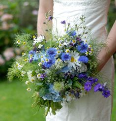 Haven't seen a wedding for such a long time with blue but this 'freshly picked from the garden' bouquet of fresh flowers and greenery is so pretty