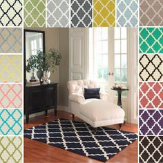Overstock.com is a great resource for rugs. They are inexpensive enough, that when you want to change your look, you won't have $1000's sunk into a rug.