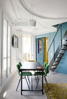 love that blue wall and steel staircase