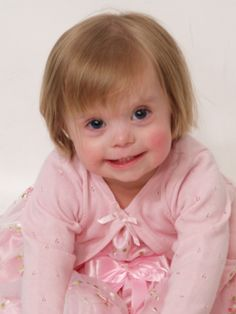 Such a beautiful child, full of wonder and spunk.....who just happens to be a child who has down syndrome.