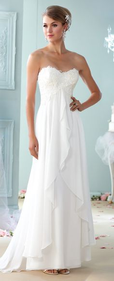 This lace and chiffon A-line gown features a sweetheart neckline, empire lace bodice, a sweep train and a matching shawl and removable straps.