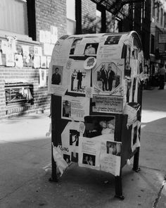 Notices and pictures of missing persons posted on a city mailbox, following the September 11, 2001 terrorist attack on the World Trade Center, New York City.  Photography by David Finn, 2001.