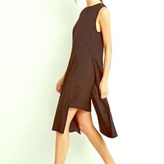 Layered Slit Dress Brand new with tag. Lovely black dress that is so easy to slip on and move freely. So casual yet easy to dress up especially because it's black! Rock this outfit with a floppy hat or your cutest booties! Forever 21 Dresses Asymmetrical