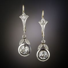 For wedding day or everyday, these gorgeous and glistening Art Deco drop earrings are just the ticket. Dazzling mine-cut diamonds are double-bezel set and accented with pretty diamond studded leaves in these exquisitely hand-fabricated platinum topped gold earrings - circa 1920s. With 1.05 carats total of mine-cut diamonds and secure wires with leverbacks, the earrings measure 1 1/4 inch long by 5/16 inches wide.