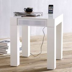 The $319 Parsons Audio End Table eliminates the need for the charging station, external speakers and audio cables. The table itself has an electrical cable to power the speakers and charge the phone.