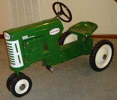 Oliver tractor pedal car~kinda like the one daddy got him :-)