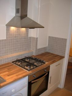 The kitchen was from Magnet Trade and is a shaker cream with walnut block effect laminate worktop.  http://www.ppmsltd.co.uk
