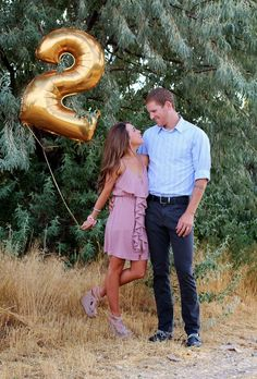 Love this idea for your anniversary pictures!  Buy one of each number as a bridal shower gift for the couple to use on their anniversary.  Find large metallic  mylar numbers at Afloral.com