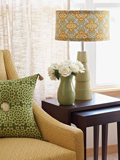 Big Impact with a Little Fabric  If you love your lamp base but the shade needs help, give it a facelift with a modern fabric. Working with a drum shade allows you to use almost any textile; a tapered shade looks best with a small overall print or a solid fabric that doesn't require a pattern match.