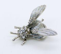 "Vintage Hattie Carnegie Rhinestone Trembler Wasp Brooch. Set in silver tone metal. Signed Hattie Carnegie. Measures 1 1/2"". Some stones have been replaced."