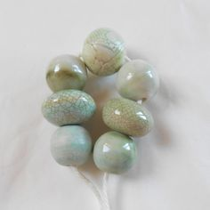 Porcelain bead set including some that are crackle glazed and one bead wrapped in layers.  Dreamy beads