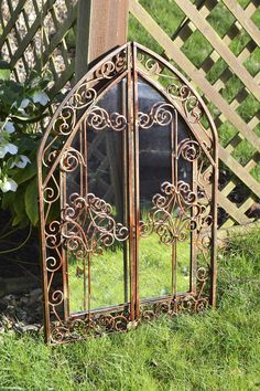 This beautiful bronze garden mirror boats detailing all around! What are your thoughts to this?