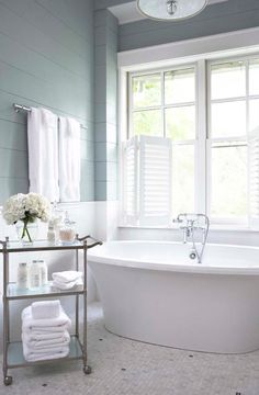 Chic Master Bathroom Boasts Upper Walls Painted Gray Blue And - Luxury bath towels sale for small bathroom ideas