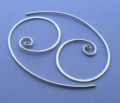 Sterling silver spiral hoop earring by atelierblaauw on Etsy