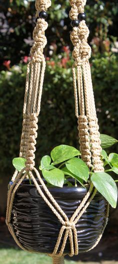 CROWNE ROYALE in JUTE macrame plant hanger by Chiron Creations.