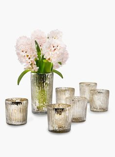 These silver ribbed votive holders have an antique mercury glass look and are available in two sizes - 2.5in & 5in. Several together make a great centerpiece.