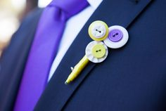 Wedding theme: Lovebirds Wedding colours: purple & yellow  Groom's brooch, made with buttons (just like my wedding buquet)