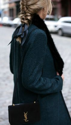 topsy layered french braid, satin ribbon, emerald green coat with fur removable collar, hoop earrings, ysl suede shoulder bag