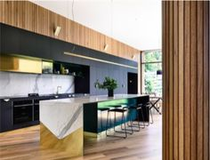 COLOUR COMBINATION Medium walnut grain timber with dark cabinetry, possible gold accents. Not the marble - perhaps off white, or concrete look benchtops. Gold Accents, Color Combinations, Concrete, Kitchen Design, Kitchens, Marble, Colour, Dark, Medium