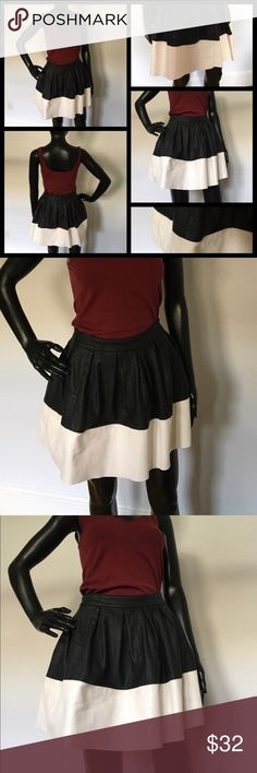 🌼NEW🌼 Adorable fake leather ASOS skirt, size 4 🌼NEW🌼 Adorable black & white fake leather ASOS skirt, size 4. Great for winter. The skirt closes with a zipper in the back. The fabric is Polyurethane. ASOS Skirts Mini