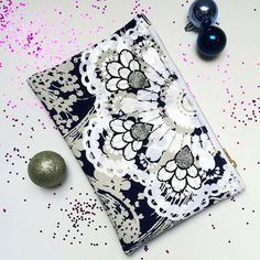 Items similar to EMBELLISHED CLUTCH PURSE cut from navy and white patterned vintage fabric with a white gloss print and silver glitter jewels. on Etsy Clutch Bags, White Vinyl, Polka Dot Print, Vintage Dress, Silver Glitter, Navy And White, Printing On Fabric, Applique, Jewels